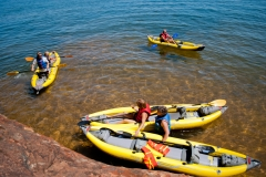 We use inflatable kayaks to explore the caves on Sand and Devils Islands.